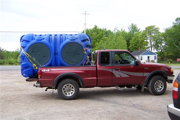 Truck carrying septic tank